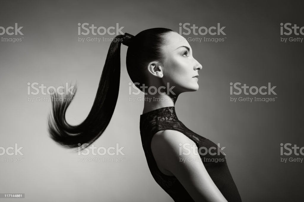 Fashion portrait of beautiful woman with ponytail stock photo