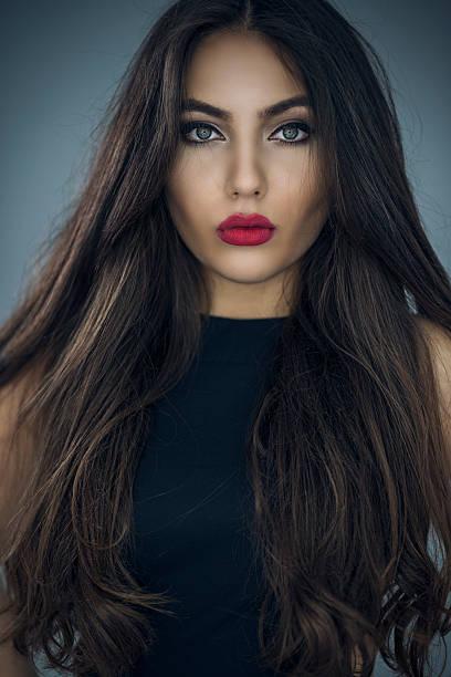 Fashion Portrait of Beautiful Young Woman with Long Hair – zdjęcie