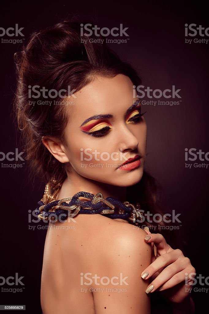 Fashion Portrait Of Browneyes Woman Gold Jewelry Orange Yellow