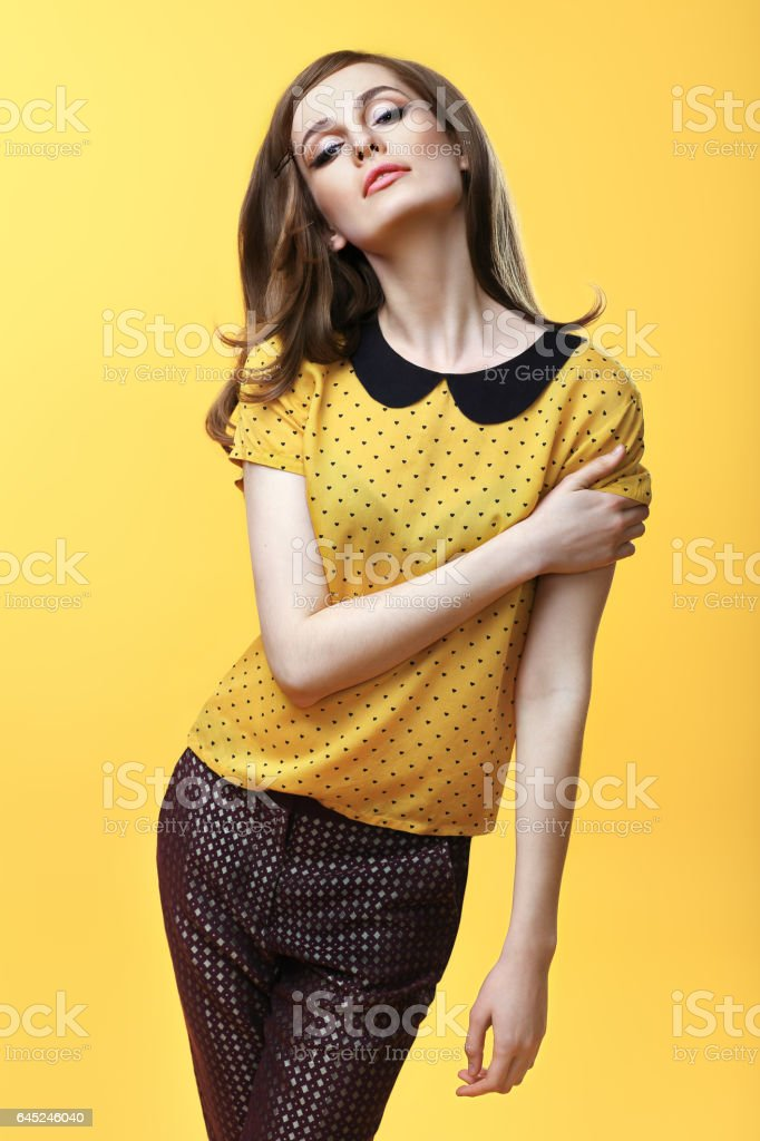 Fashion portrait of confident beautiful woman posing stock photo