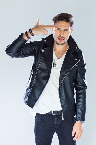 Fashion Portrait Of Macho Wearing Leather Jacket Stock Photo - Download Image Now
