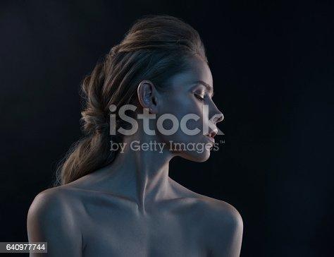 istock Fashion portrait of model in the light colored spotlights. 640977744