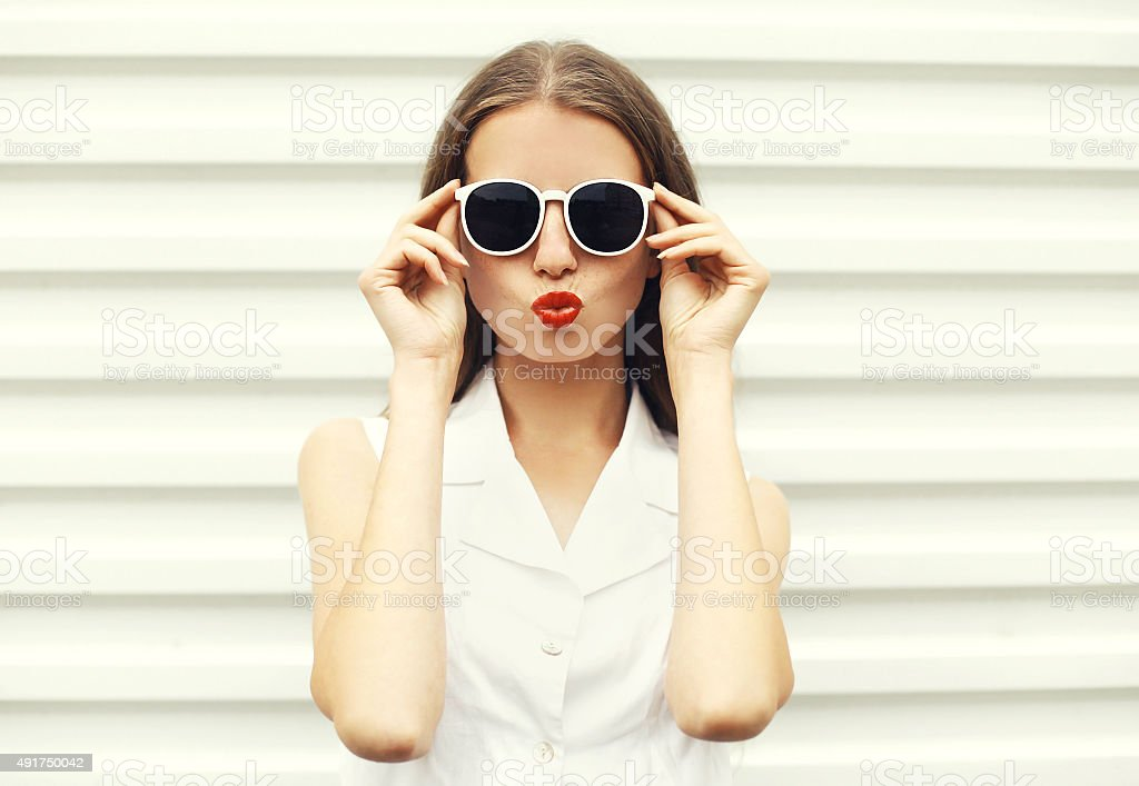 Fashion portrait of pretty young woman in white sunglasses royalty-free stock photo