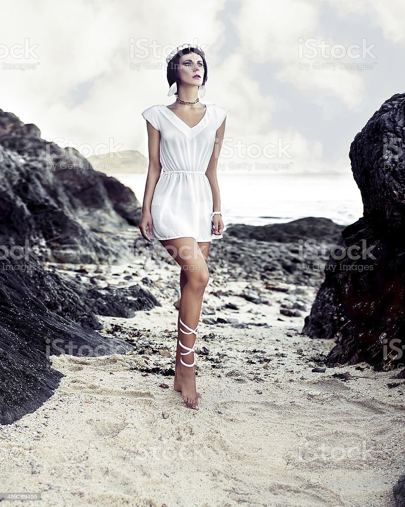fashion portrait of sensual girl on the rocks stock photo