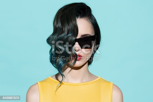 istock Fashion portrait of sensual stylish woman on a blue background. 545982520