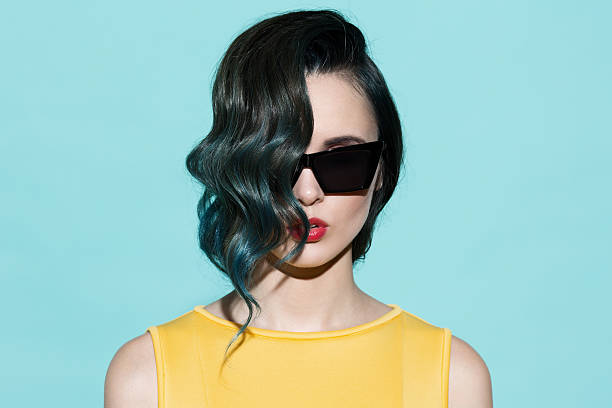 fashion portrait of sensual stylish woman on a blue background. - pop art stock photos and pictures