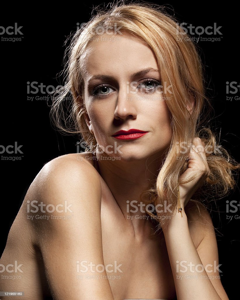 Fashion portrait of sensual young woman on black background royalty-free stock photo