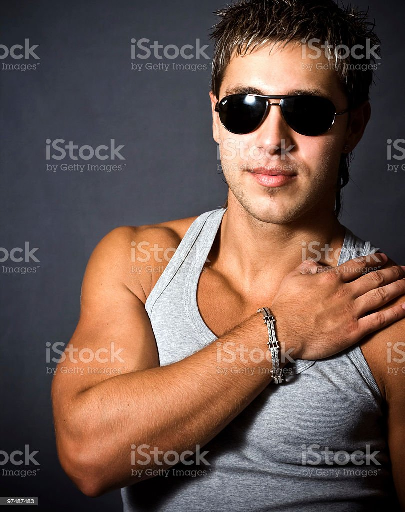 Fashion portrait of sexy man with sunglasses royalty-free stock photo
