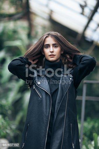 istock Fashion portrait of stylish pretty woman straightens hai 932837152