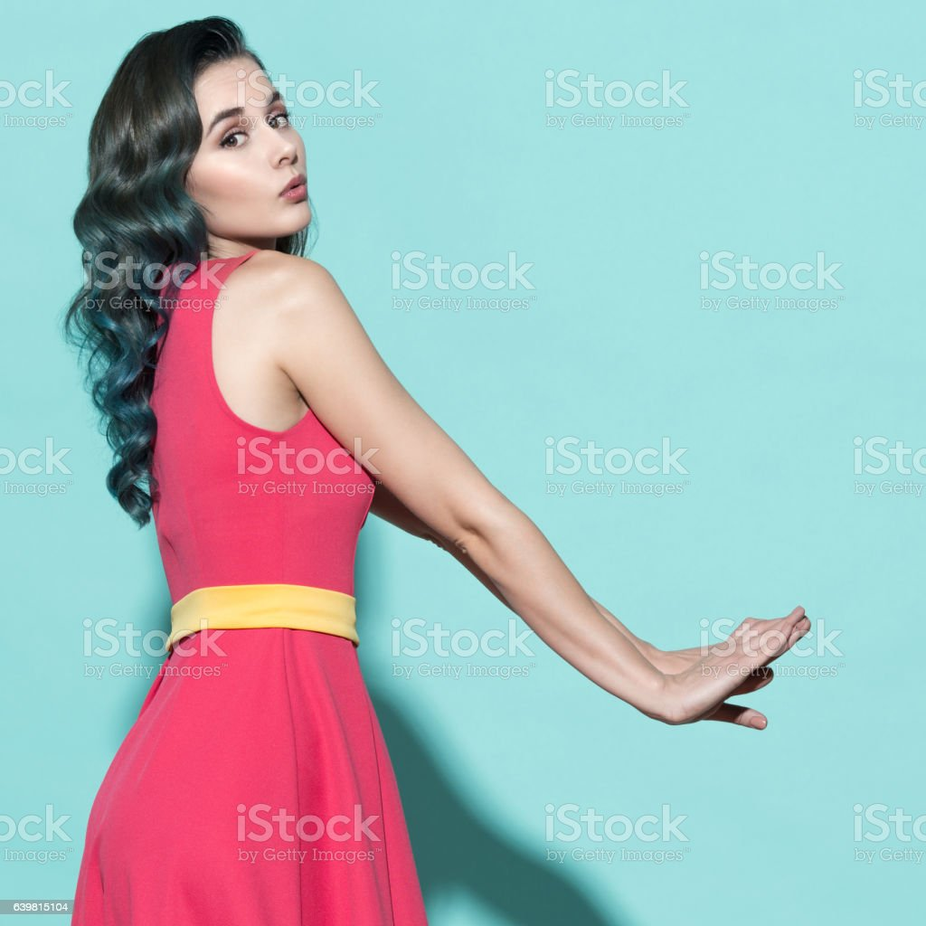 Fashion portrait of stylish woman in a pink dress. stock photo