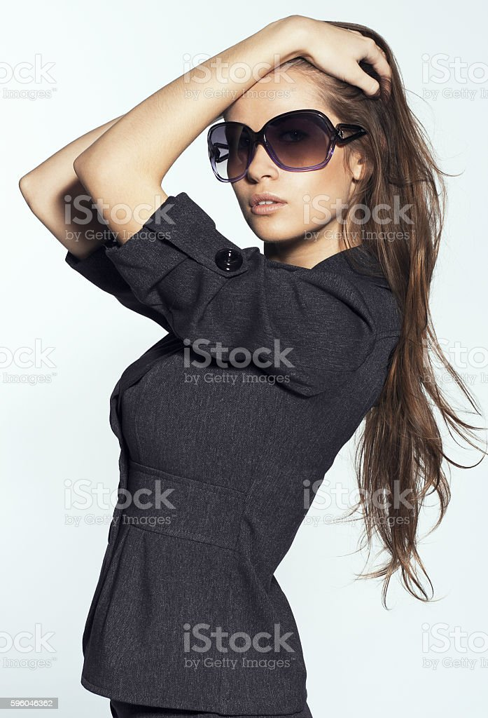 Fashion portrait of the young sexual brunette wearing sunglasses royalty-free stock photo