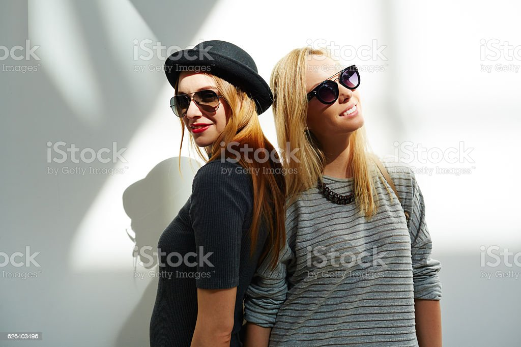 Fashion portrait of two female friends stock photo