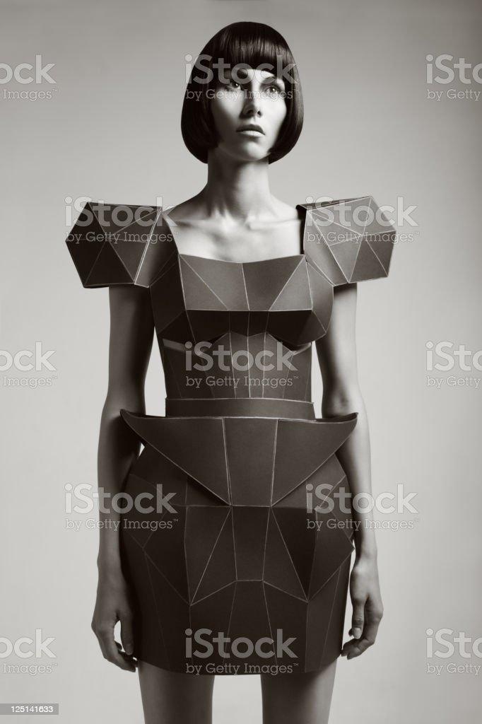 Fashion portrait of woman in futuristic dress royalty-free stock photo