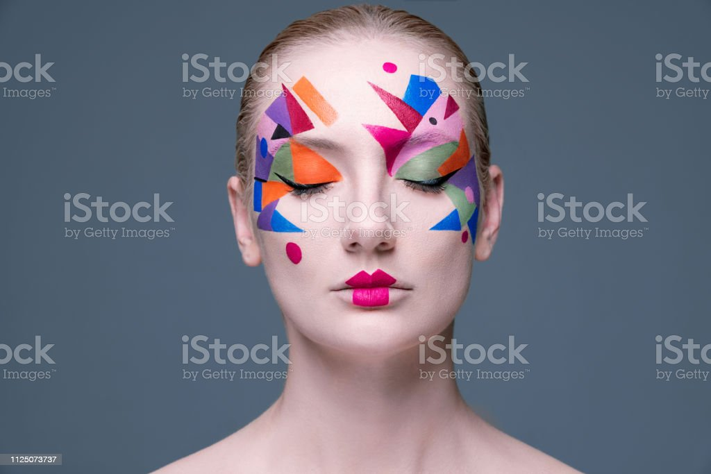 Fashion Portrait of Woman With Artistic Colorful Make-up stock photo