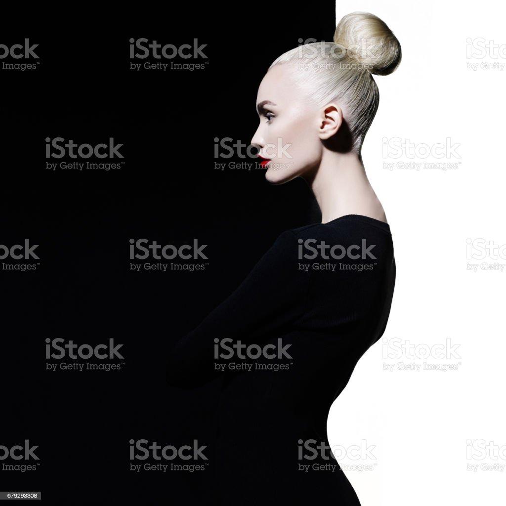 Fashion portrait of young beautiful woman in black dress stock photo