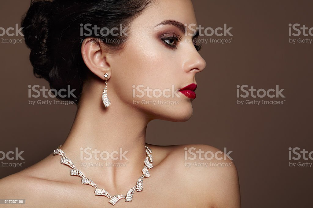 Fashion portrait of young beautiful woman with jewelry. Brunette...