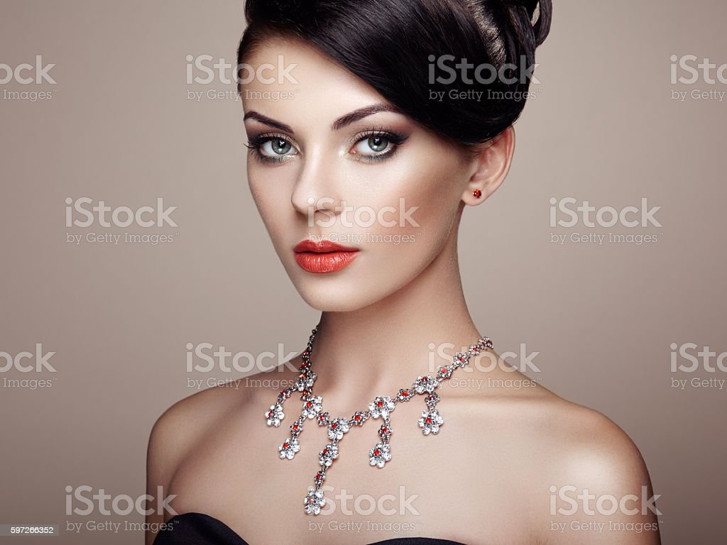 Fashion portrait of young beautiful woman with jewelry royalty-free stock photo