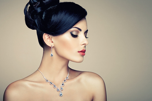 Fashion portrait of young beautiful woman with jewelry stock photo