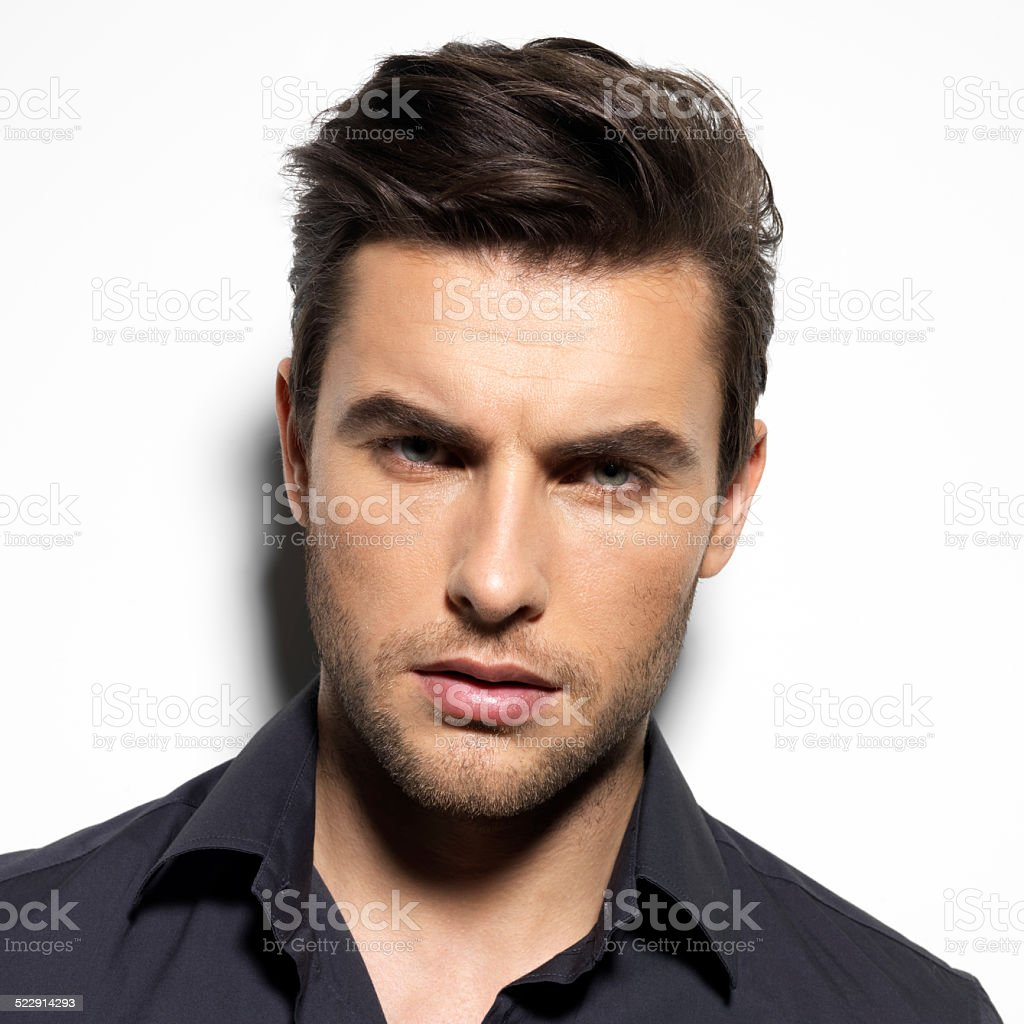Fashion portrait of young man in black shirt stock photo