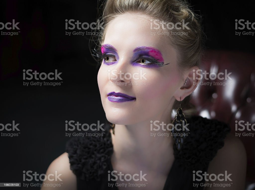 Fashion portrait of young woman in chair. stock photo