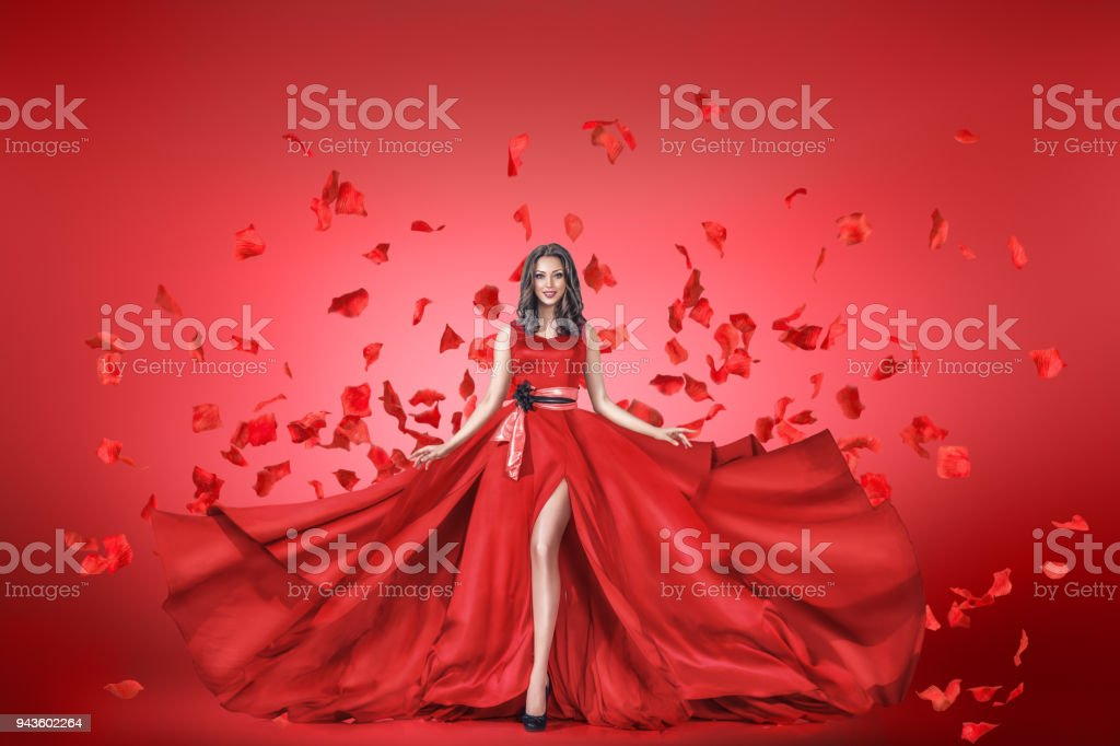 Fashion portrait of young woman in long dress stock photo