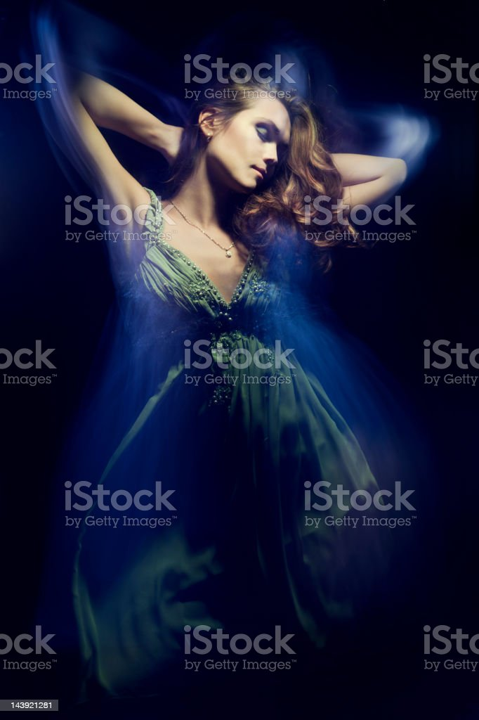 Fashion portrait of young woman on black background. royalty-free stock photo