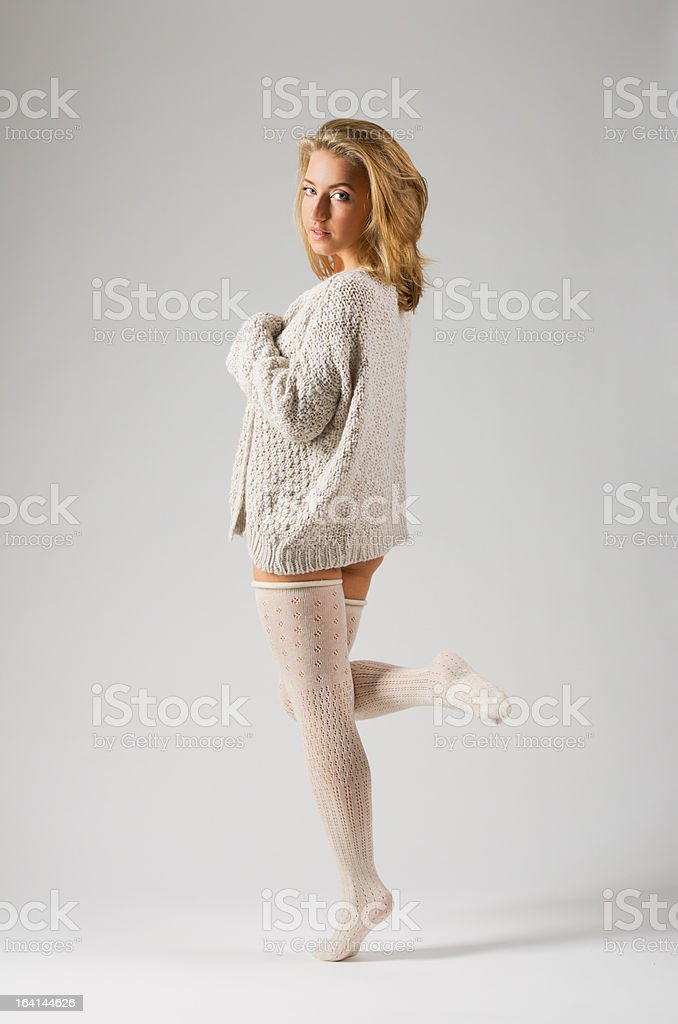 Fashion portrait of young woman on grey royalty-free stock photo