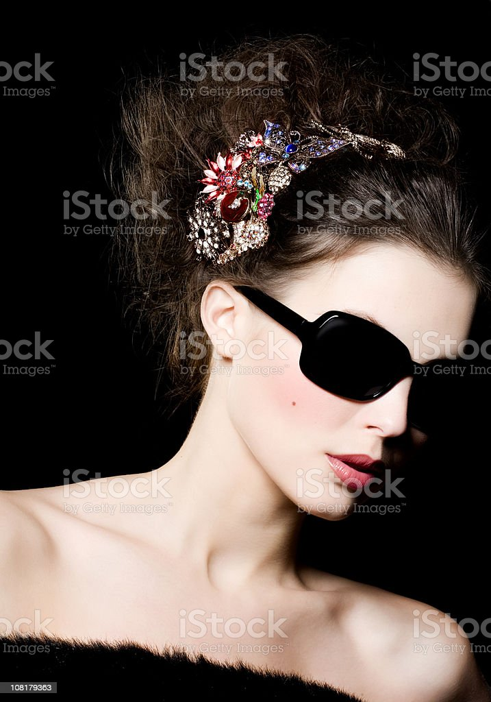 Fashion Portrait of Young Woman Wearing Sunglasses royalty-free stock photo
