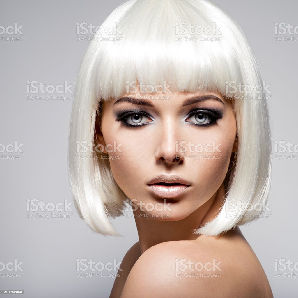 Fashion portrait of young woman with blond hairs and black stock photo