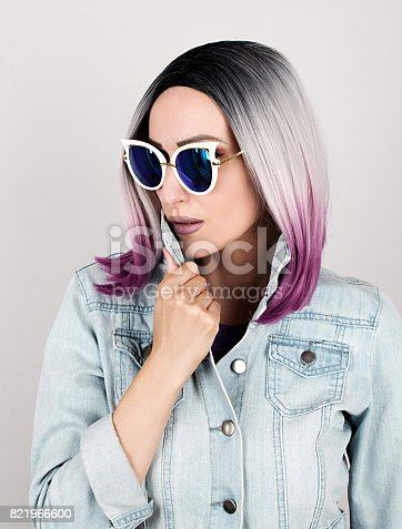 istock Fashion portrait of young woman with sunglasses 821966600
