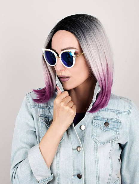 Fashion portrait of young woman with sunglasses stock photo