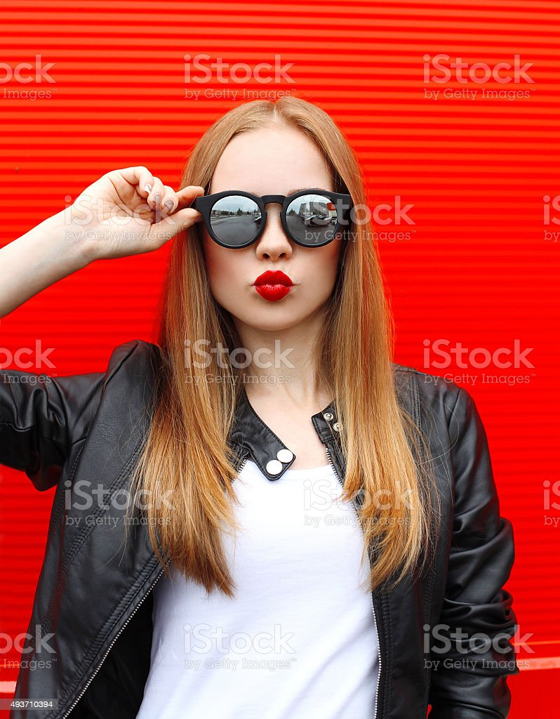 Fashion portrait pretty blonde woman with red lipstick wearing a stock photo