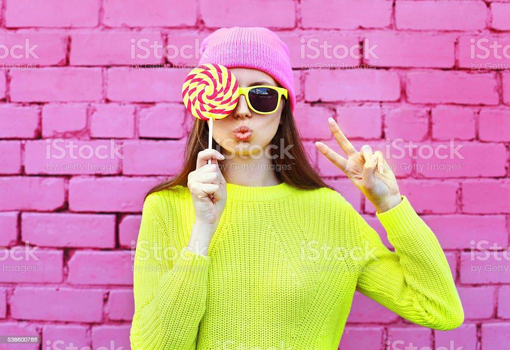 Fashion portrait pretty cool girl with lollipop having fun over stock photo