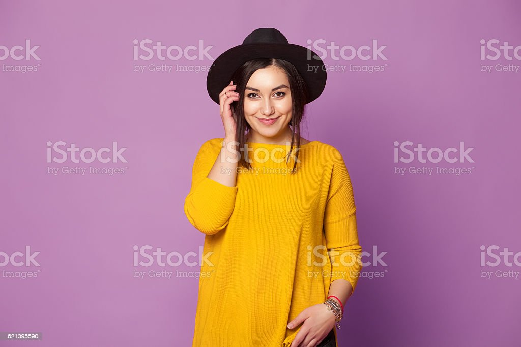 Fashion portrait pretty cool girl with modern hat stock photo