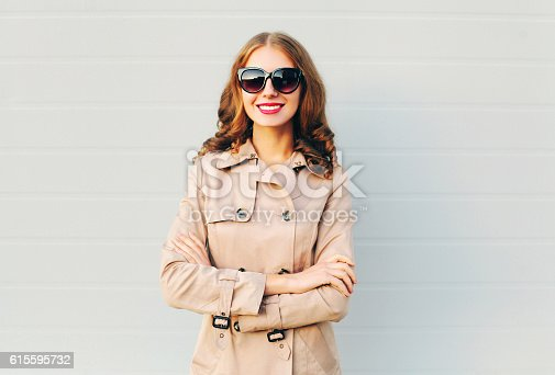 istock Fashion portrait pretty smiling woman wearing a coat 615595732