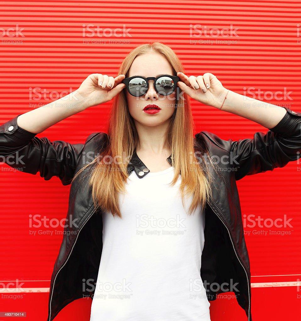 Fashion portrait pretty stylish woman with red lipstick wearing stock photo