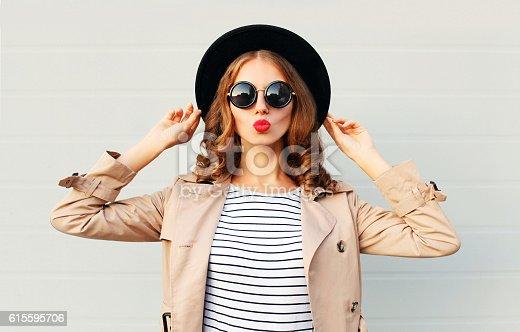 istock Fashion portrait pretty sweet woman blowing red lips, black hat 615595706