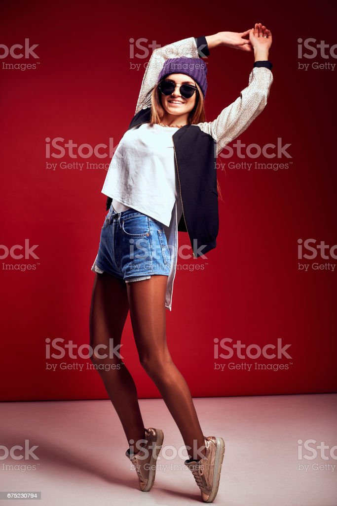 Fashion portrait pretty woman in street style over red background royalty-free stock photo