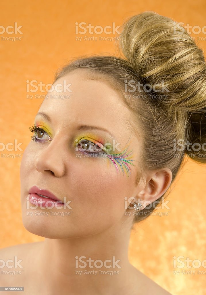 Fashion portrait with parrot style makeup royalty-free stock photo