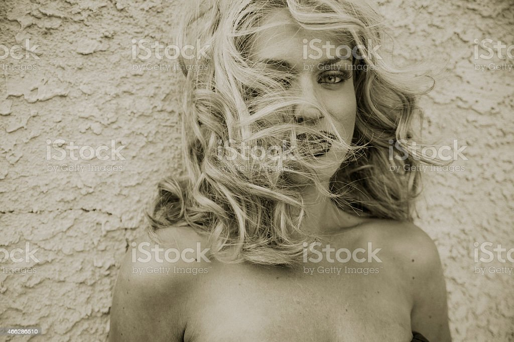 fashion portrait with wind tousled hair stock photo
