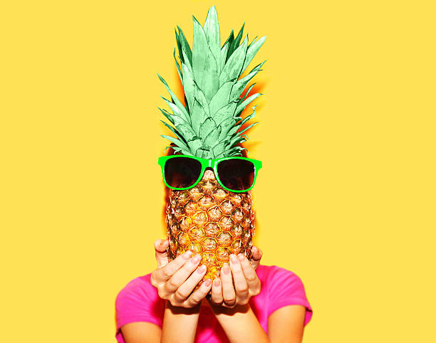 fashion portrait woman and pineapple with sunglasses over colorful yellow - beach fashion stock photos and pictures