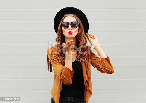 529664088istockphoto Fashion portrait woman blowing red lips sends air sweet kiss 618200502