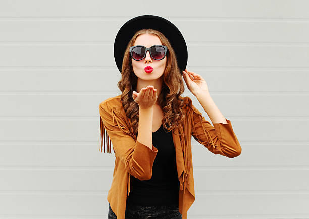Fashion portrait woman blowing red lips sends air sweet kiss stock photo