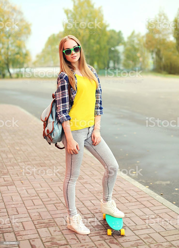 Stylish And Trendy Blonde Teen Girl Is Posing Over Yellow