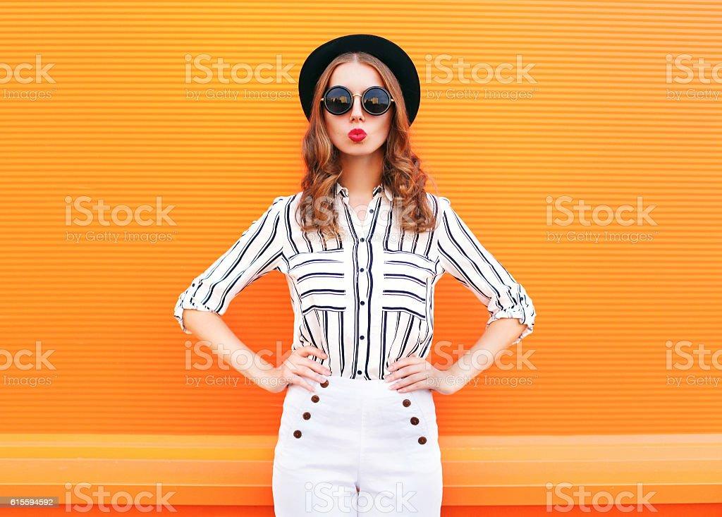 Fashion pretty glamour woman wearing a black hat sunglasses pants stock photo