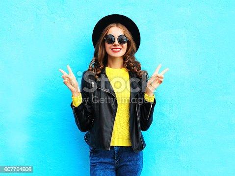 istock Fashion pretty smiling cool woman wearing a black rock style 607764606