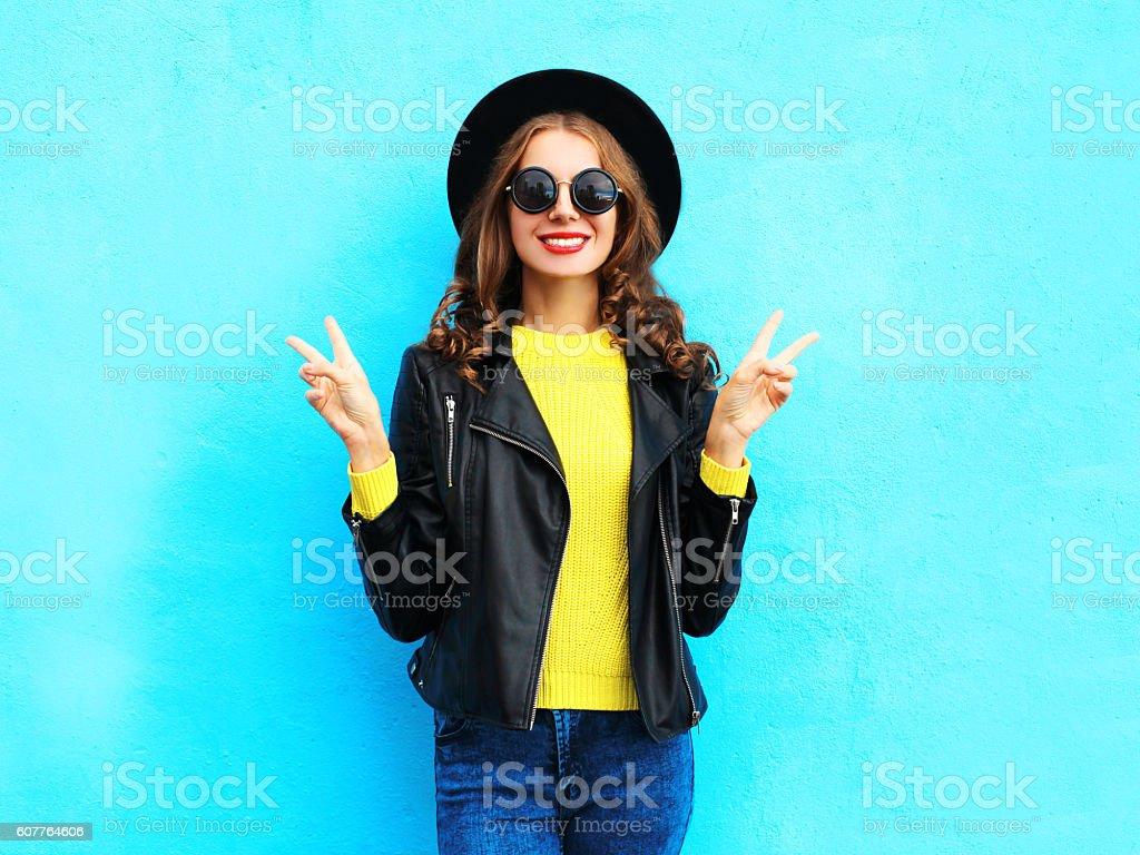 Fashion pretty smiling cool woman wearing a black rock style stock photo