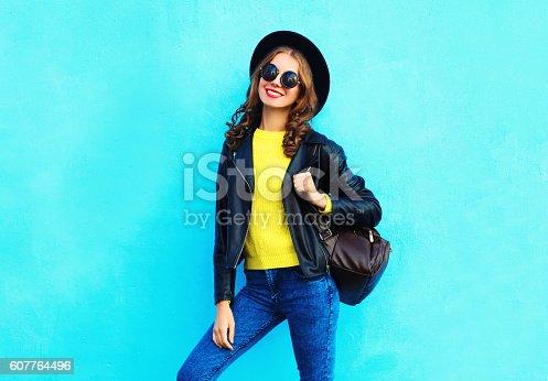 istock Fashion pretty smiling woman wearing a black rock style 607764496