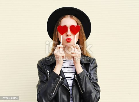529664088istockphoto Fashion pretty sweet woman having fun with lollipop over white 529666052
