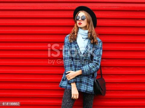 istock Fashion pretty woman wearing black hat coat jacket and handbag 618199852